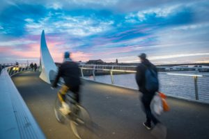 An atmospheric picture of a shared bike and pedestrian bridge.