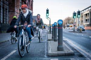Two hijabi-wearing female cyclists using a segregated cycle path.