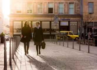 Two women walking through a pedestrianised zone