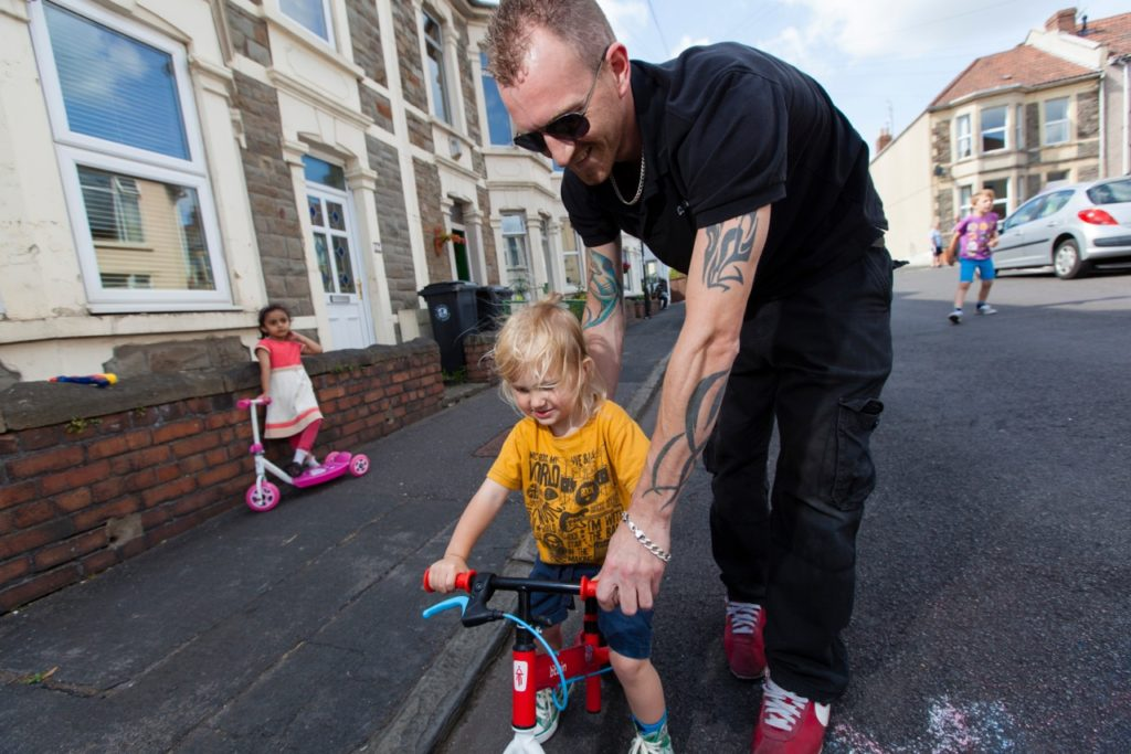 Dad helping child to ride