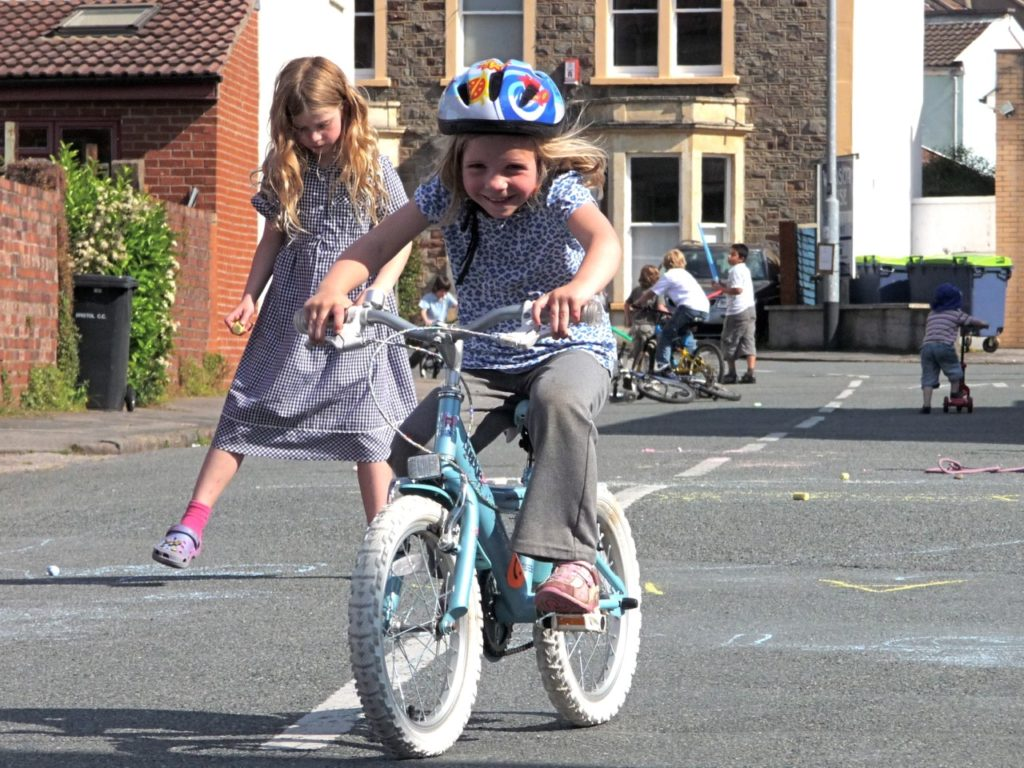 girl cycling on closed road