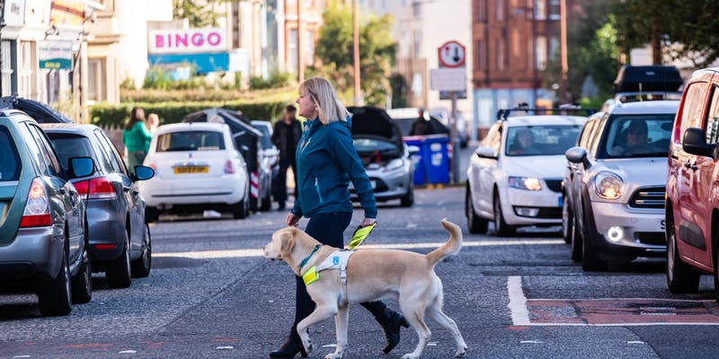 Shona crossing the road with her dog Woody