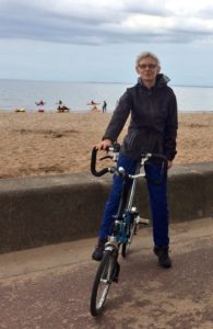 Kirsty on her (non-electric) Brompton