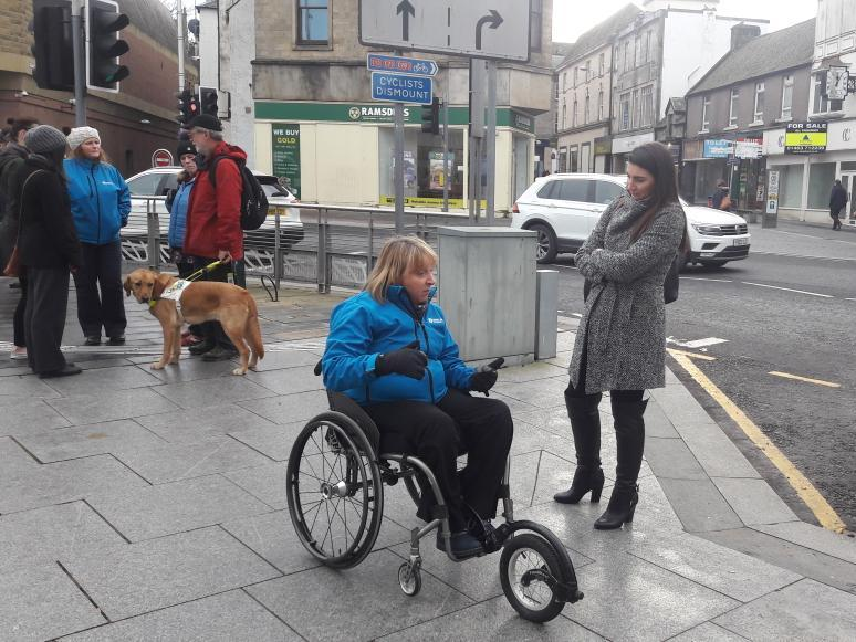 Conversation between wheelchair user and able-bodied participant